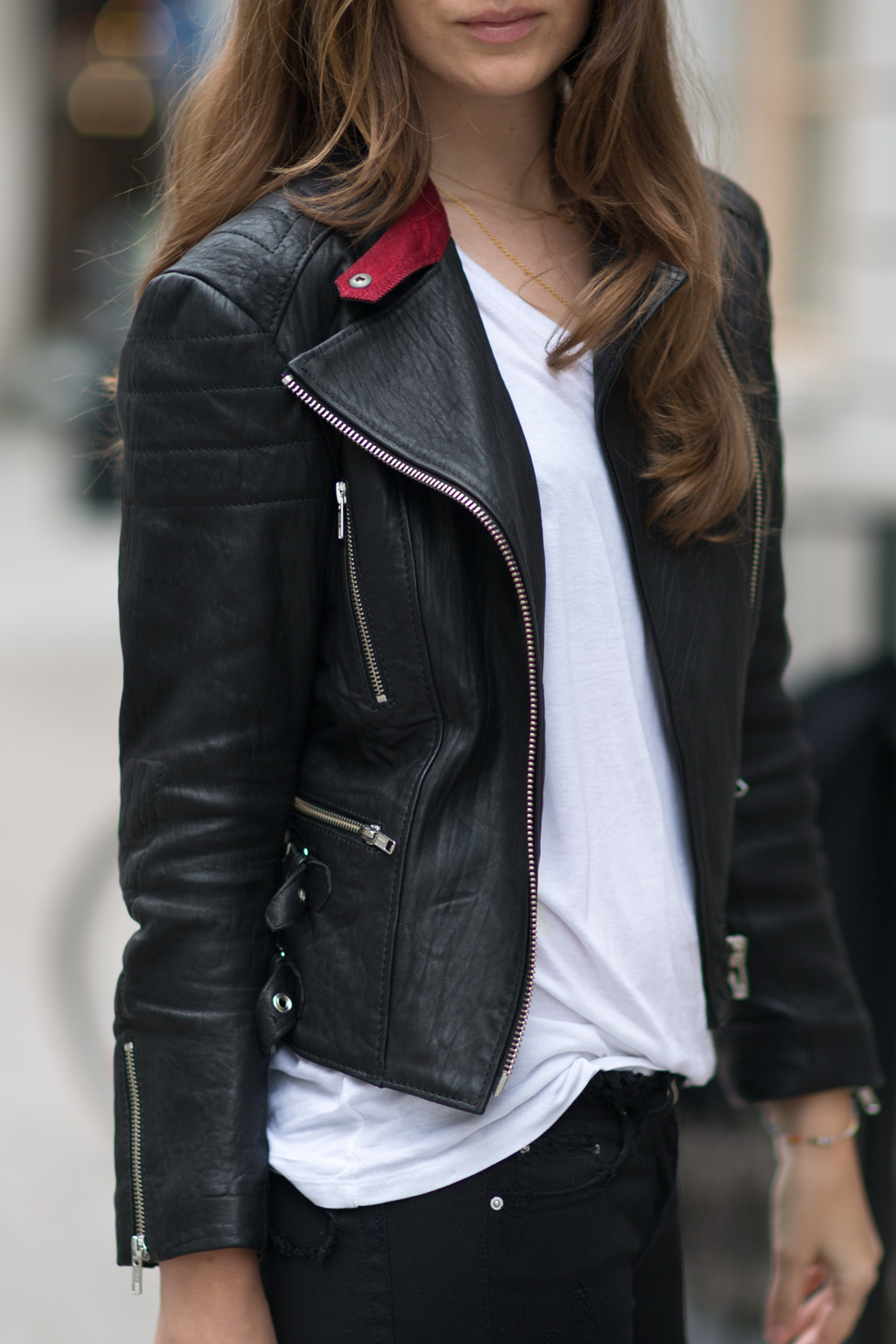 Wearing a leather jacket