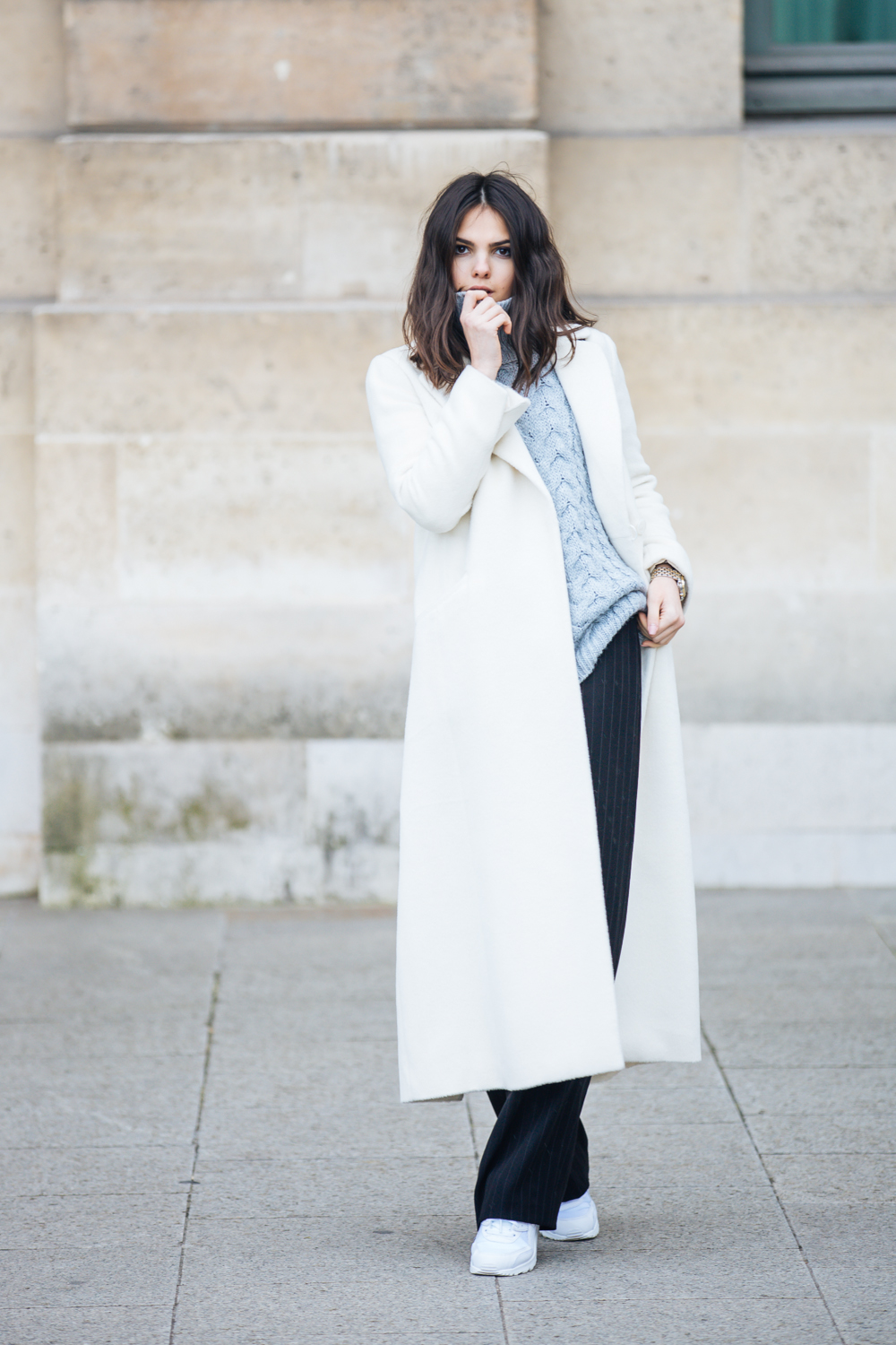 Fashion Blogger Doina Ciobanu In Trousers From Emporio Armani Zara Turtleneck White Coat From Jaeger Celine bag Nike trainers