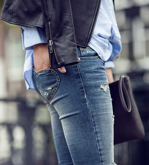 Rebecca Laurey Is Wearing Leather Jacket From West 14th, Light Blue Shirt From Mango, Distressed Jeans, Shoes And Clutch From Twin-Set