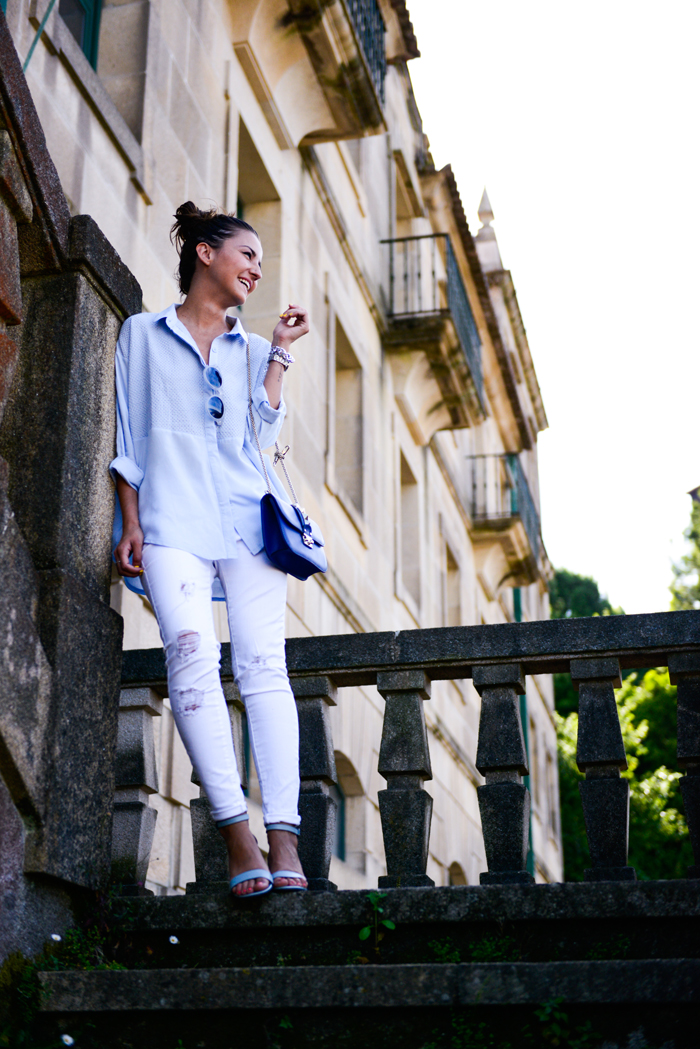 Alexandra Pereira Is Wearing Pale Blue Shirt From Chicwish, Ripped White Jeans From Suiteblanco, Shoes From Zara And Bag From Valentino