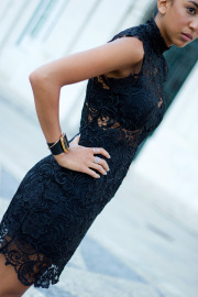 Kayla Seah is wearing a black lace dress from Misha Collection