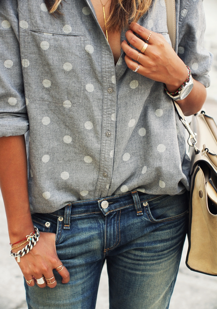 Julie Sarinana is wearing a grey and white polka dot shirt and jeans from Rag & Bone