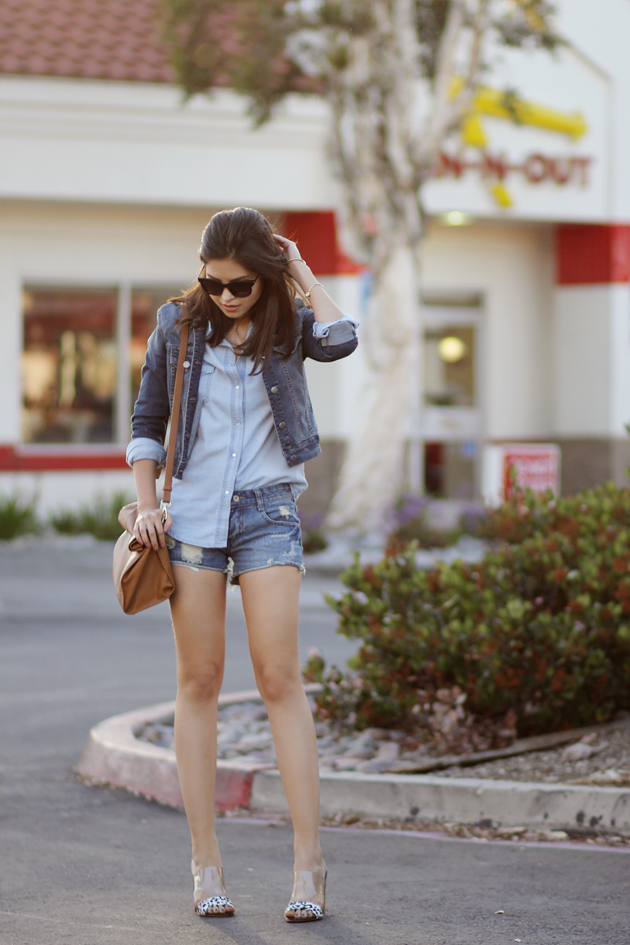 Fake Leather Is Wearing Denim Jacket From Papaya, Denim Shirt And Ripped Denim Shorts From SheInside And Lucite Sandals From Guess