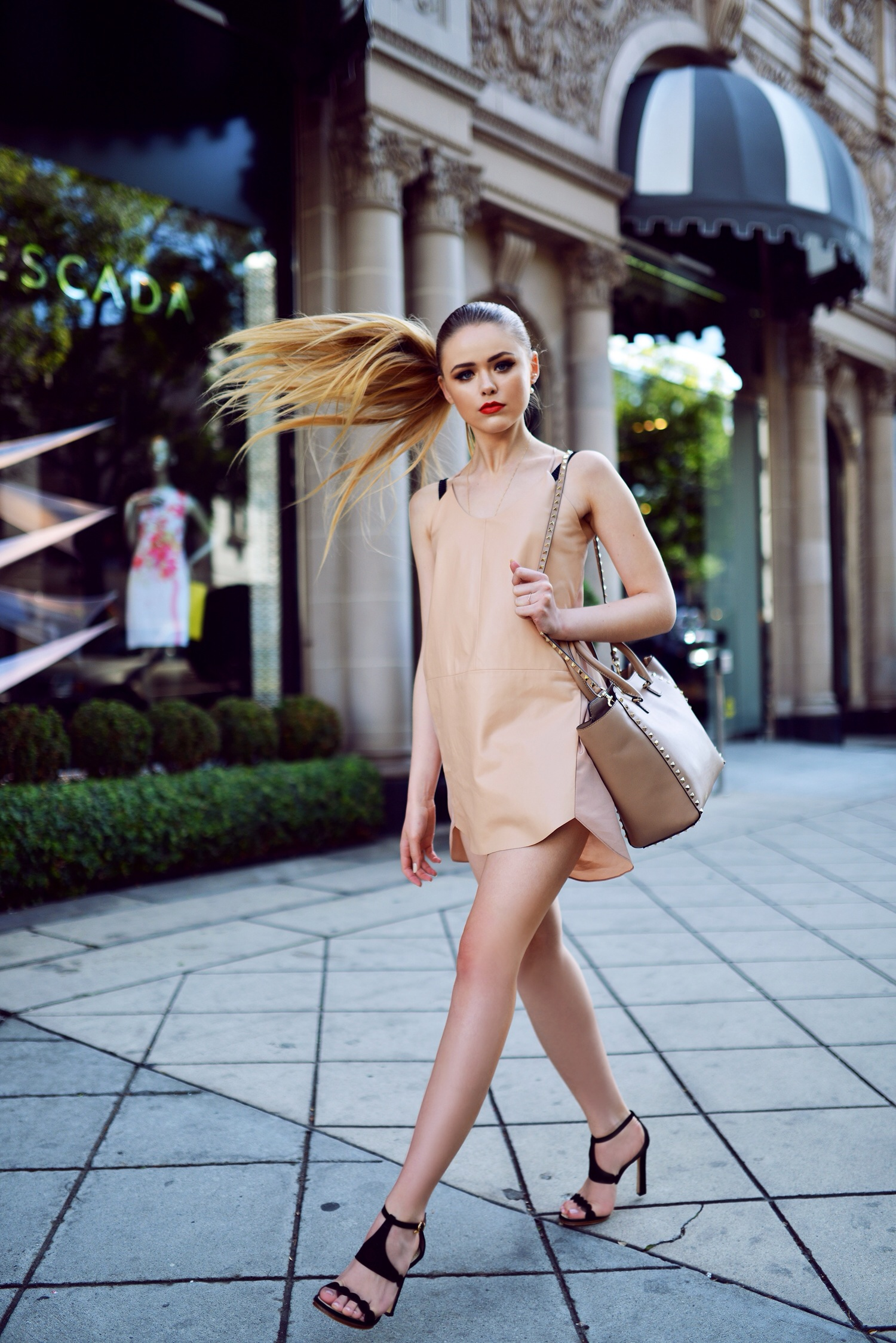Kayture Is Wearing Nude Dress From Mason, Shoes From Fabi, And Bag From Valentino