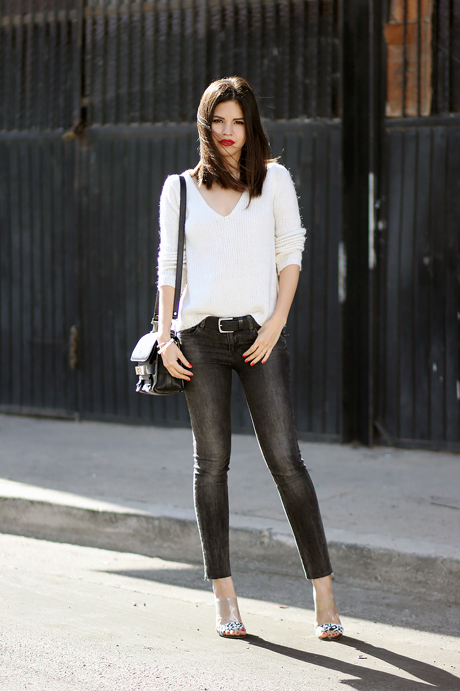 Adriana Gastélum Is Wearing Black Stone Washed Jeans From Pull & Bear, V-Neck White Jumper, PS11 Bag And Mules From Guess