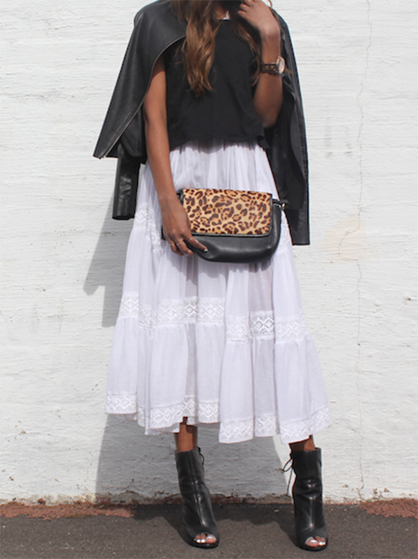 Vydia Rishie Is Wearing A Black Leather Jacket And White Maxi Dress From Bermuda, Black Top From Cotton On, Shoes From Tony Bianco And Leopard Print Bag From The Bag Department
