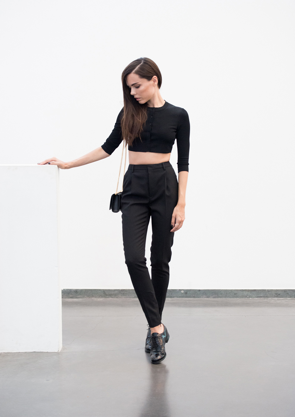 Evangelie Smyrniotaki is wearing all black top from Alaia, trousers and bag from Saint Laurent, brogues from Church's