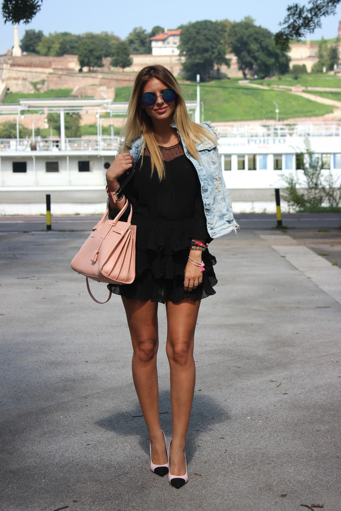 Zorana Jovanovic is wearing a black layered dress with mesh from Choies, denim vest from Zara, sunglasses from No Name, shoes and bag from Saint Laurent