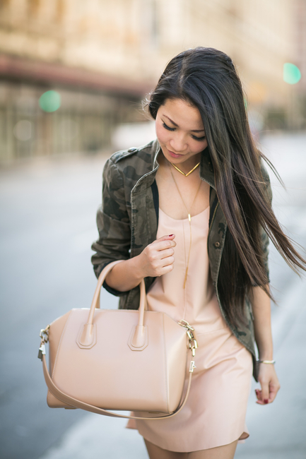 Wendy Nguyen is wearing a camo jacket from Zara, nude dress from Mason and a bag from Givenchy