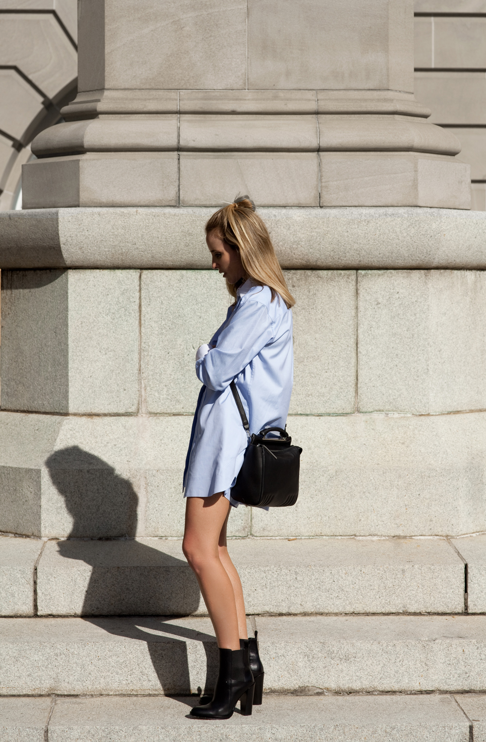Amanda Shadforth is wearing a light blue shirt, shorts and boots from Alexander Wang and satchel from 3.1 Philip Lim
