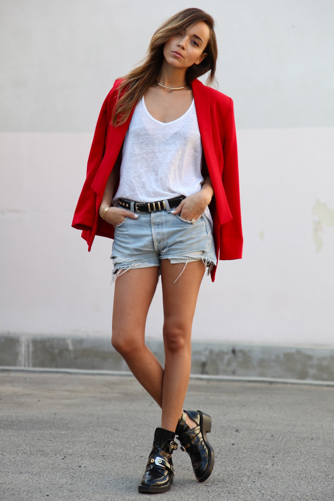 Ashley Madekwe is wearing a vintage Levi's cut offs, T-shirt from Anine Bing, jacket from Bec & Bridge and boots from Balenciaga