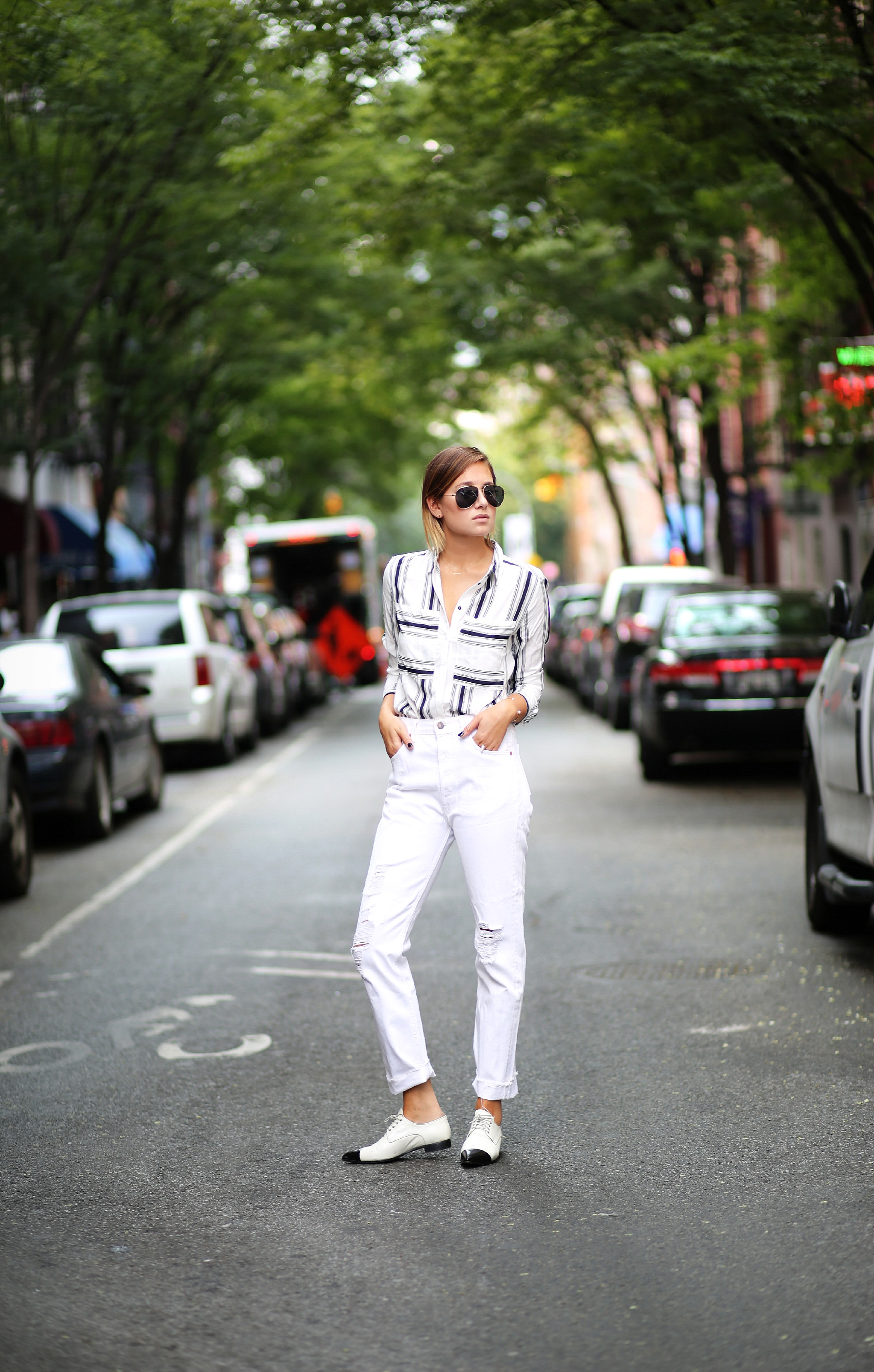 Danielle Bernstein is wearing a black and white striped shirt from H&M, white jeans from TopShop and loafers from Miu Miu