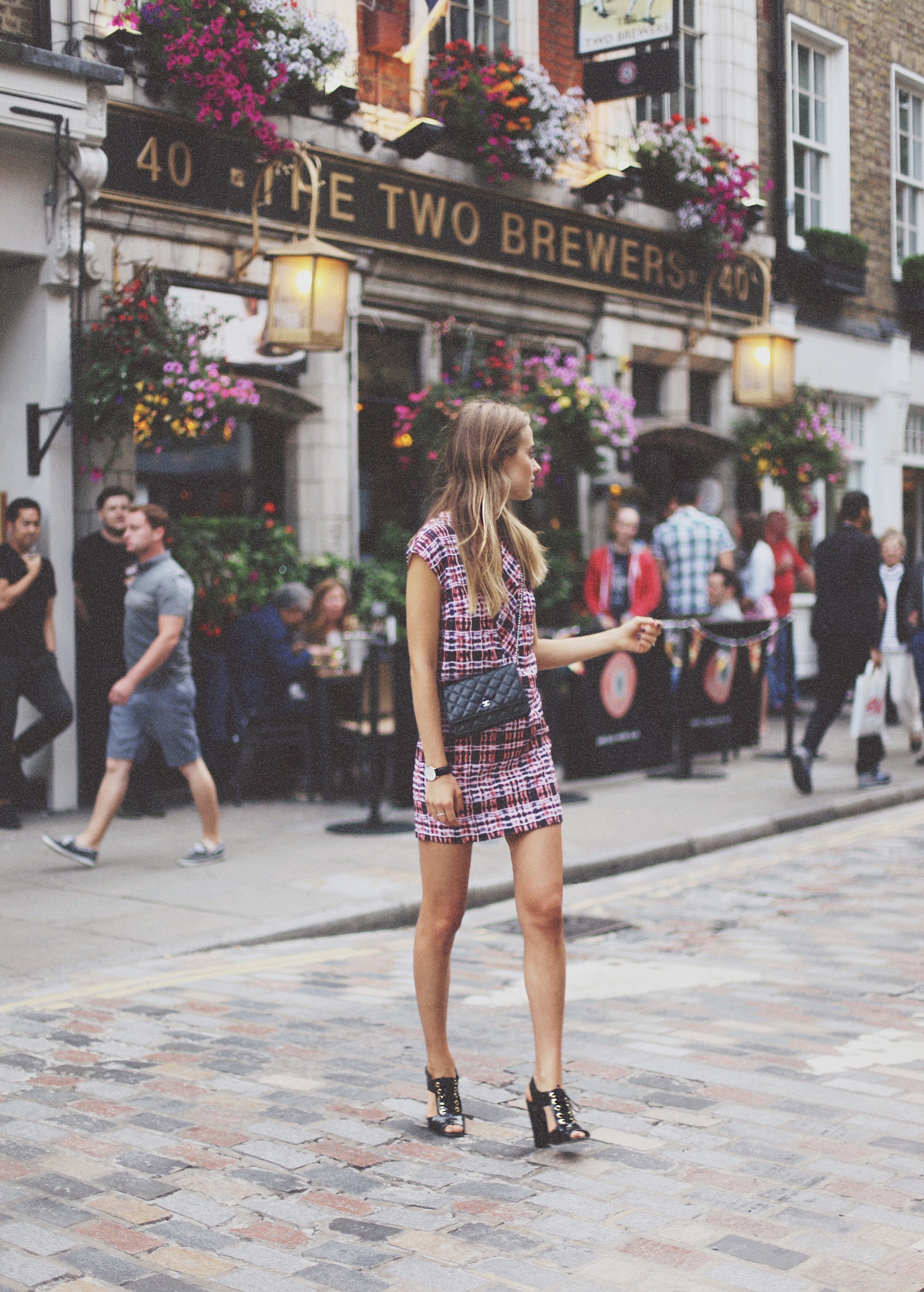 Sonya Esman is wearing a plaid dress from Finders Keepers, shoes from ASOS and a bag from Chanel