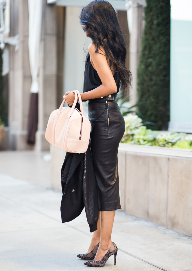 Sheryl Luke is wearing black silk cami from Maison De Papillon, skirt from Coach, jacket from Line & Dot, shoes from Sole Society and a bag from Just Fab