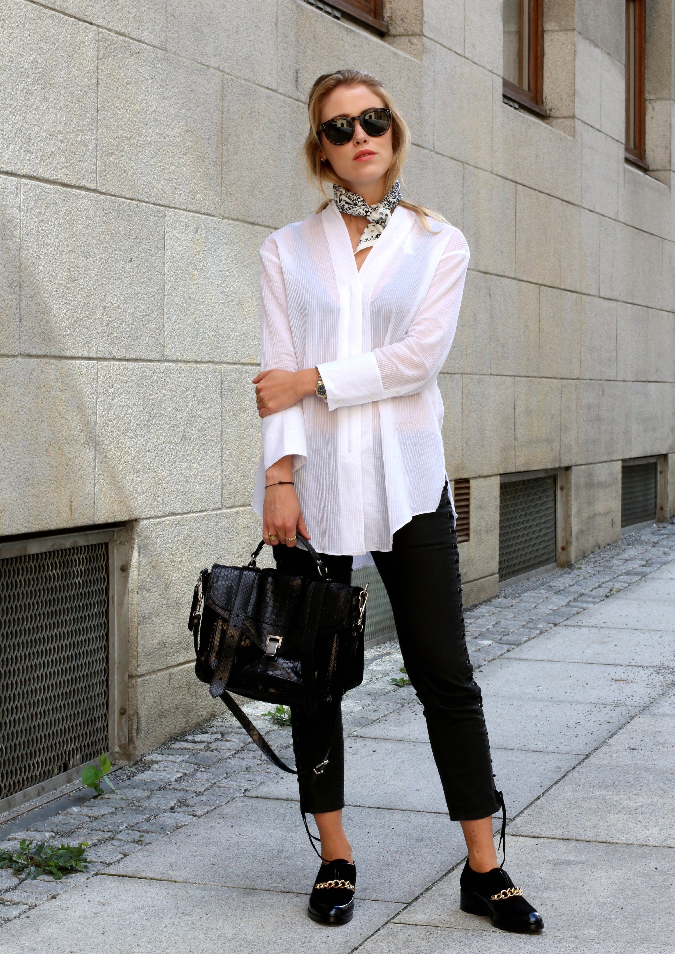 Annabel Rosendahl is wearing a white shirt from Helmut Lang, trousers from Isabel Marant, shoes from 3.1 Philip Lim, bag from Proenza Schouler and sunglasses from Celine