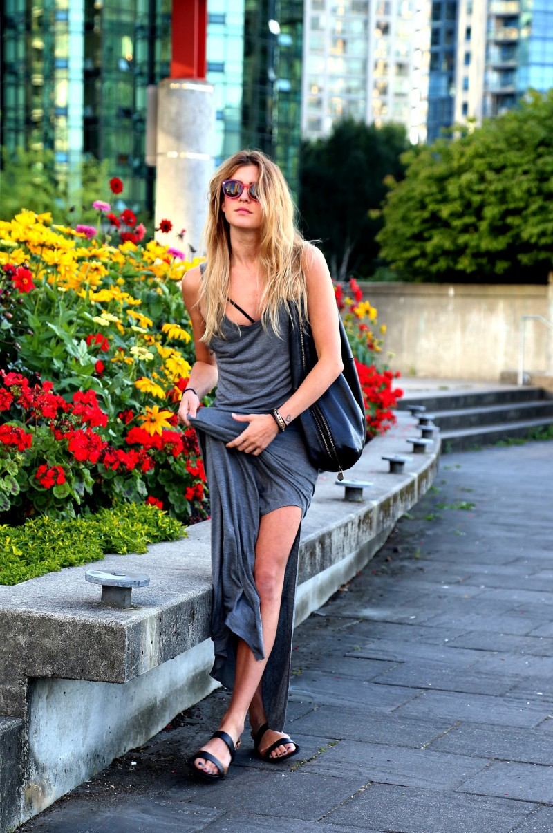 Laura Ellner is wearing sunglasses from Aframes, bag from Pour La Victoire and the grey dress is from Reformation