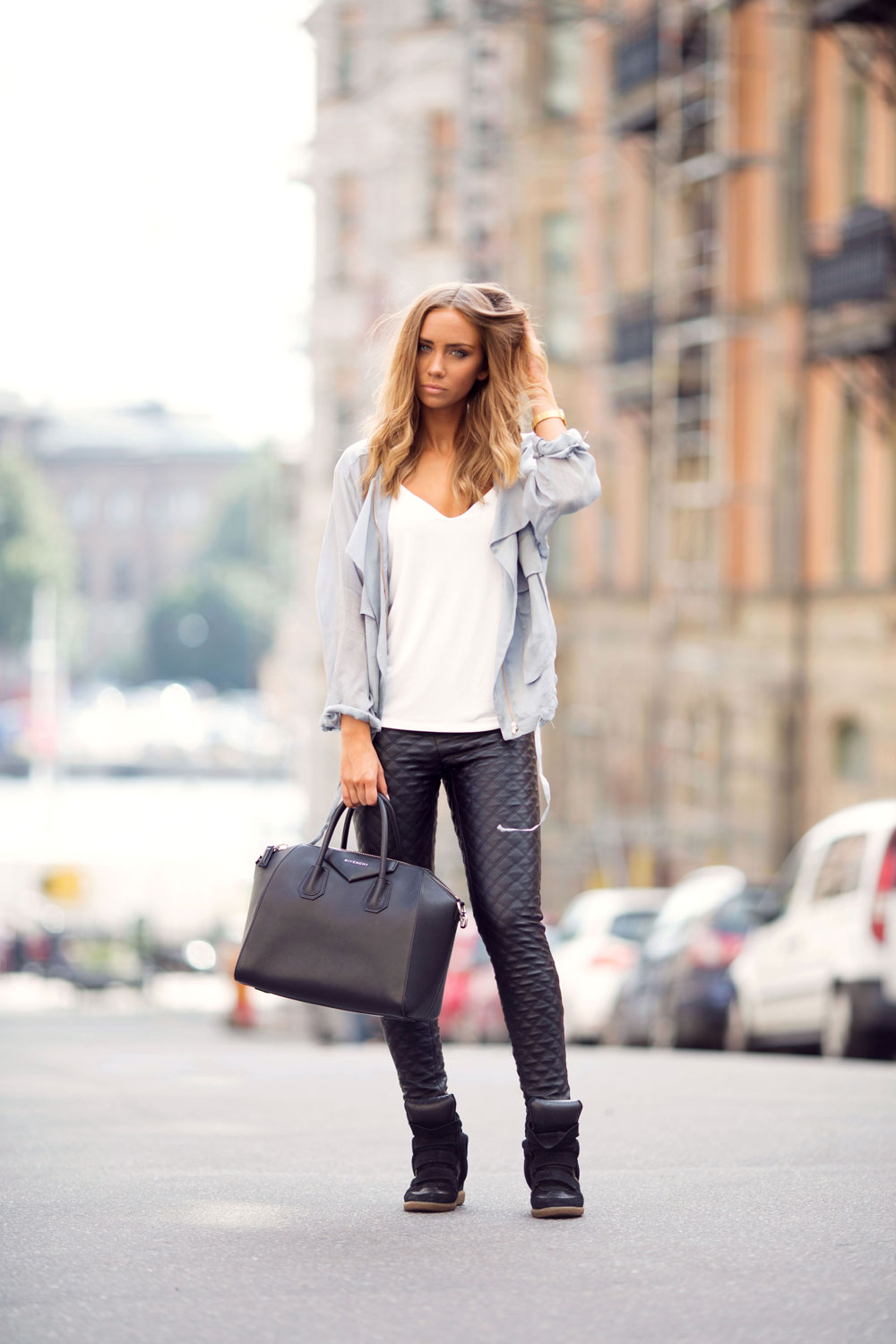 Lisa Olsson is wearing a white top from Gina Tricot, quilted leather trousers from Nelly, shoes from Isabel Marant, jacket from Zara and the bag is from Givenchy