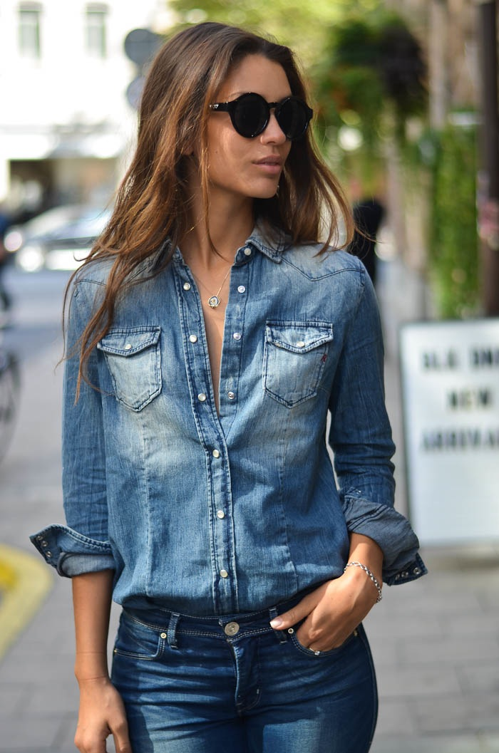 Damla Yaraman is wearing a denim shirt from Replay, jeans from Levi's and sunglasses from JunkYard
