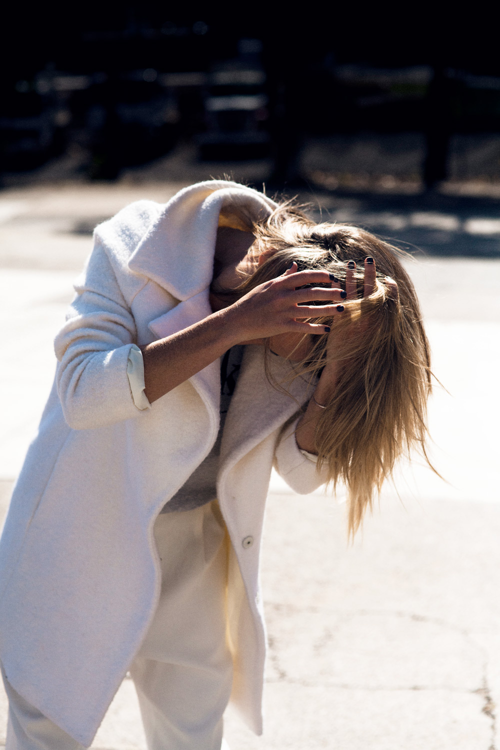 Mandy Shadforth is wearing an oversized white coat from Carven, grey T-shirt and and white trousers from Ellery