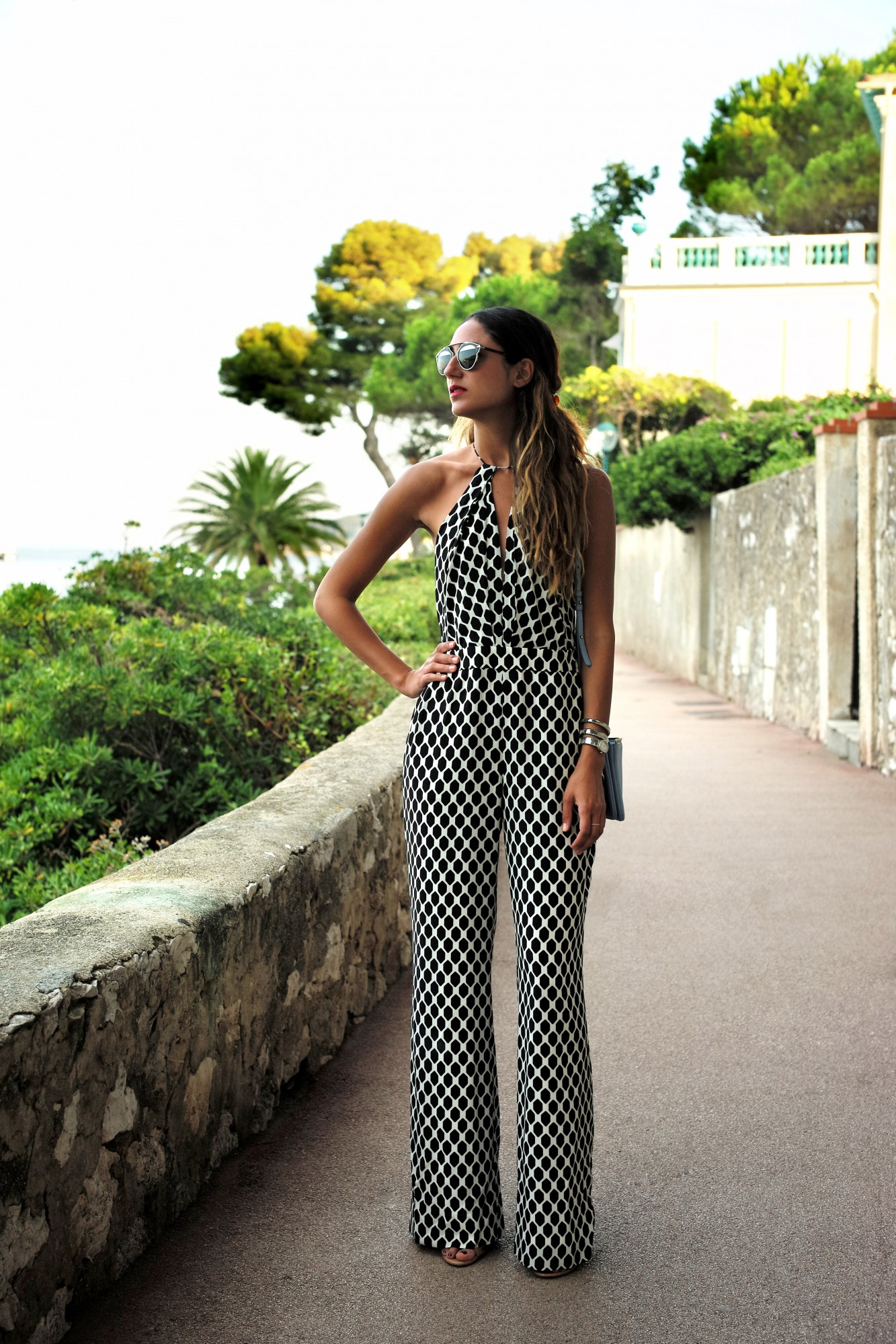 Soraya Bakhtiar is wearing a geometric patterned jumpsuit from Diane Von Furstenberg Jumpsuit