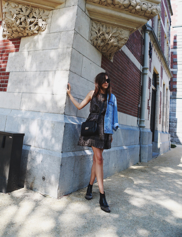 Andy Torres is wearing a dress from & Other Stories, boots from By Malene Birger, sunglasses from Miu Miu, denim jacket from ASOS and the bag is from Neri Karra