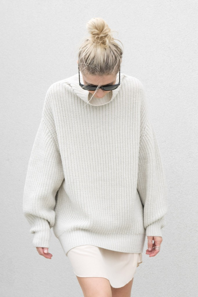 Figtny is wearing an oversized knit top and slip dress from Aritzia Wilfred
