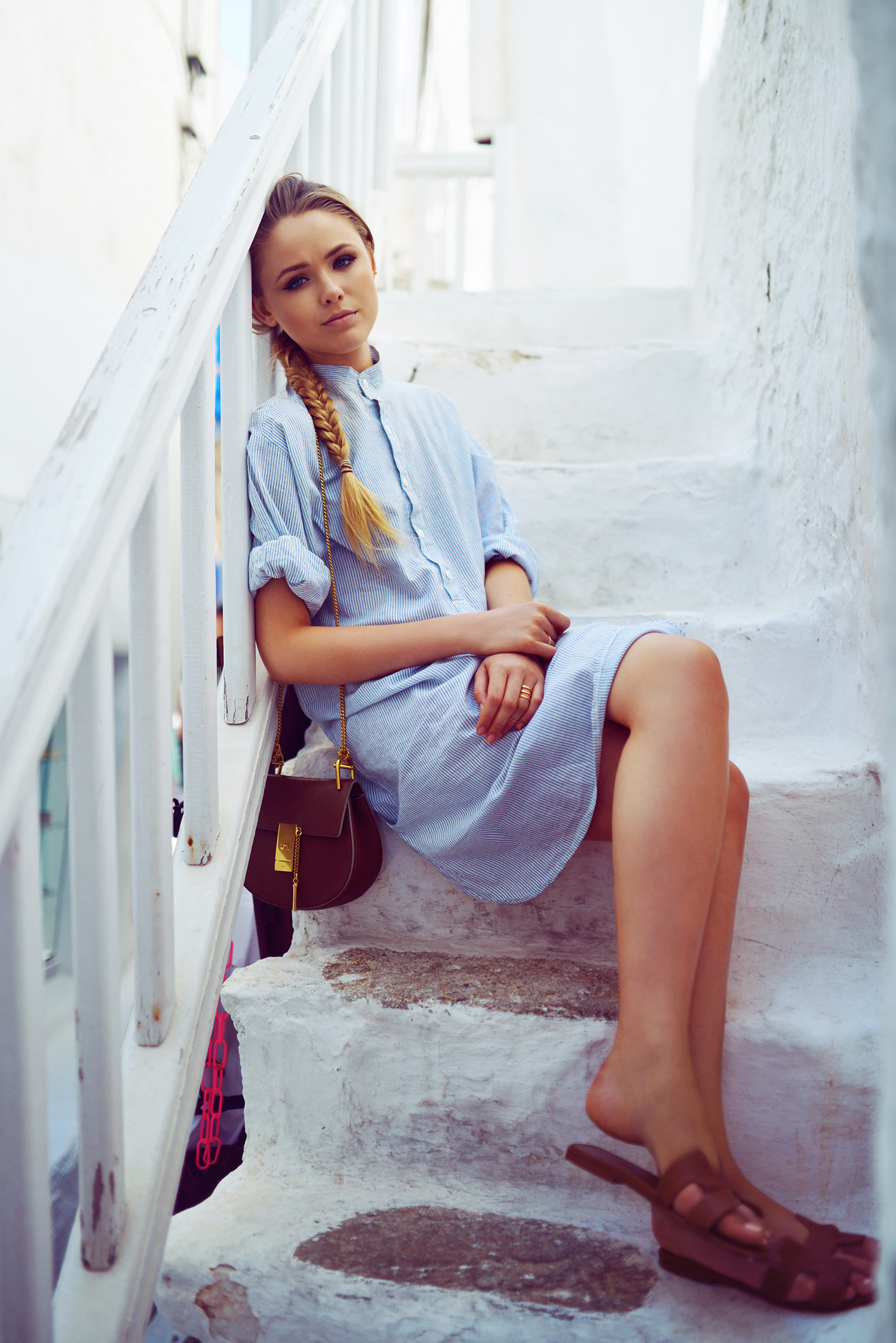 Kristina Bazan is wearing a shirt dress, shoes from Hermes and the bag is from Chloe