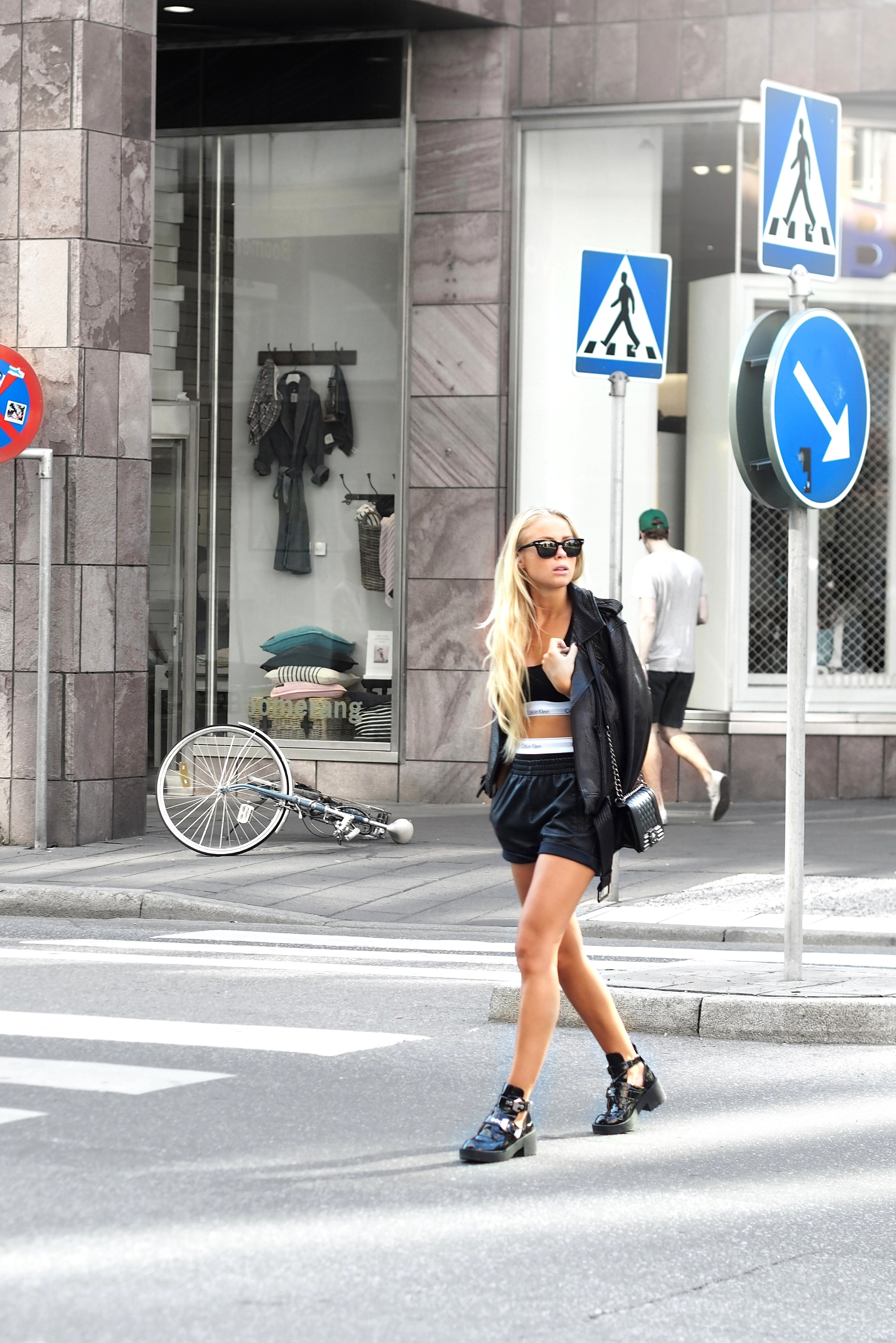 Victoria Tornegren is wearing black shorts from NLY, jacket from FWSS, bra and boxers from Calvin Klein, shoes from Jeffrey Campbell and sunglasses from RayBan