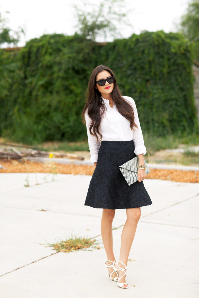 Rachel Parcell is wearing a white shirt, black skirt and clutch from J. Crew, shoes from Jimmy Choo and sunglasses from Celine