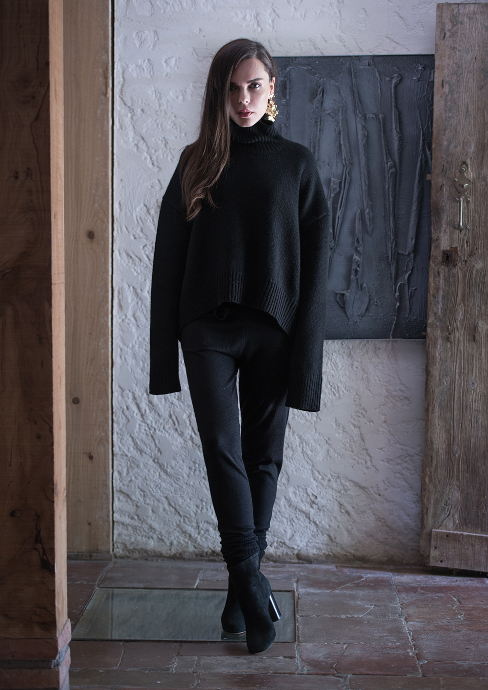 Evangelie Smyrniotaki is wearing an oversized black sweater from Celine, trousers and boots from Isabel Marant