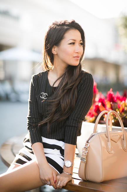 Wendy Nguyen is wearing a vertical striped top from H&M, horizontal striped skirt from Expres and a bag from Givenchy