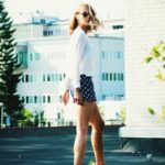 Petra Karlsson is wearing sunglasses from 80's Purple, short shorts from Zara, white top from H&M and shoes from Choies