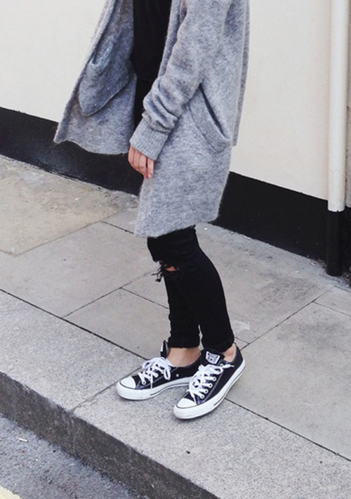 Mija is wearing black Converse and Jeans from J Brand and a grey cardigan from Acne