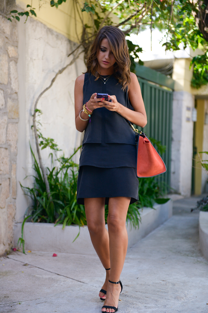 Alexandra Pereira is wearing a dress from Anine Bing, shoes from Schutz and a bag from Céline