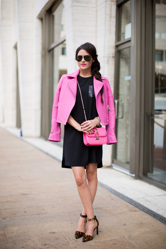 Rachel Parcell is wearing shoes from Nine West, leather jacket from J.Brand, black dress from Madewell and the bag is from Valentino
