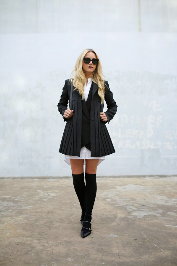 Blair Eadie is wearing a jacket and bag from Tory Burch, dress from BCBG, thigh highs from H & M, shoes from Zara and sunglasses from Prada