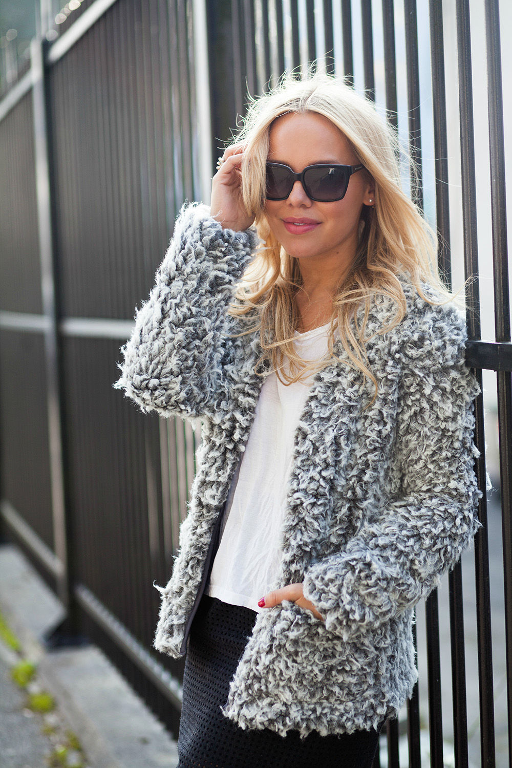 Cathrine Heienberg is wearing a furry grey jacket from Nelly, T-shirt from BikBok and the skirt is from Designers Remix