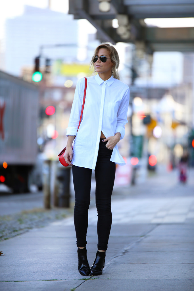 Mary Seng is wearing a white shirt from Alexander Wang, jeans from Denim AG, boots from Prada, bag from Givenchy and the sunglasses are from RayBan
