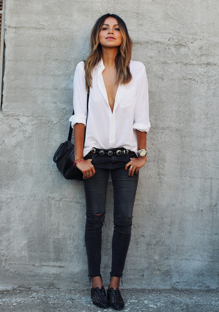 Julie Sarinana is wearing a distressed black skinny jeans from J Brand, shirt from Current/Elliott and the shoes are from Freda Salvador
