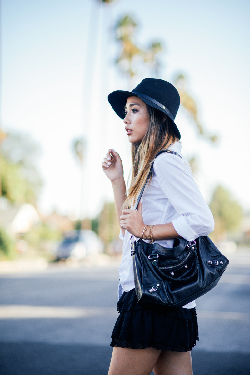 Jenny Ong is wearing a hat from Rag & Bone, skirt from UO and a bag from Balenciaga