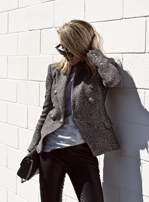Mandy Shadforth is wearing a tweed blazer from Balmain, T-shirt from Alexander Wang, trousers from Iris & Ink and the bag is from Givenchy