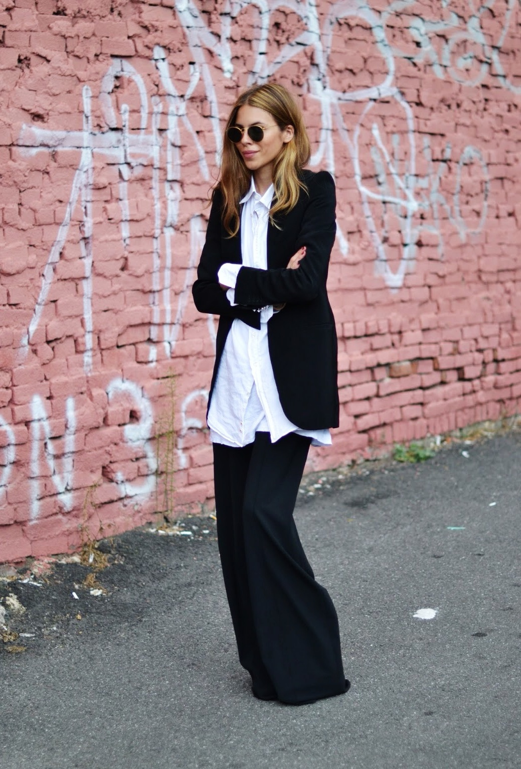 Maja Wyh is wearing a black blazer, white shirt and pants from Elizabeth and James