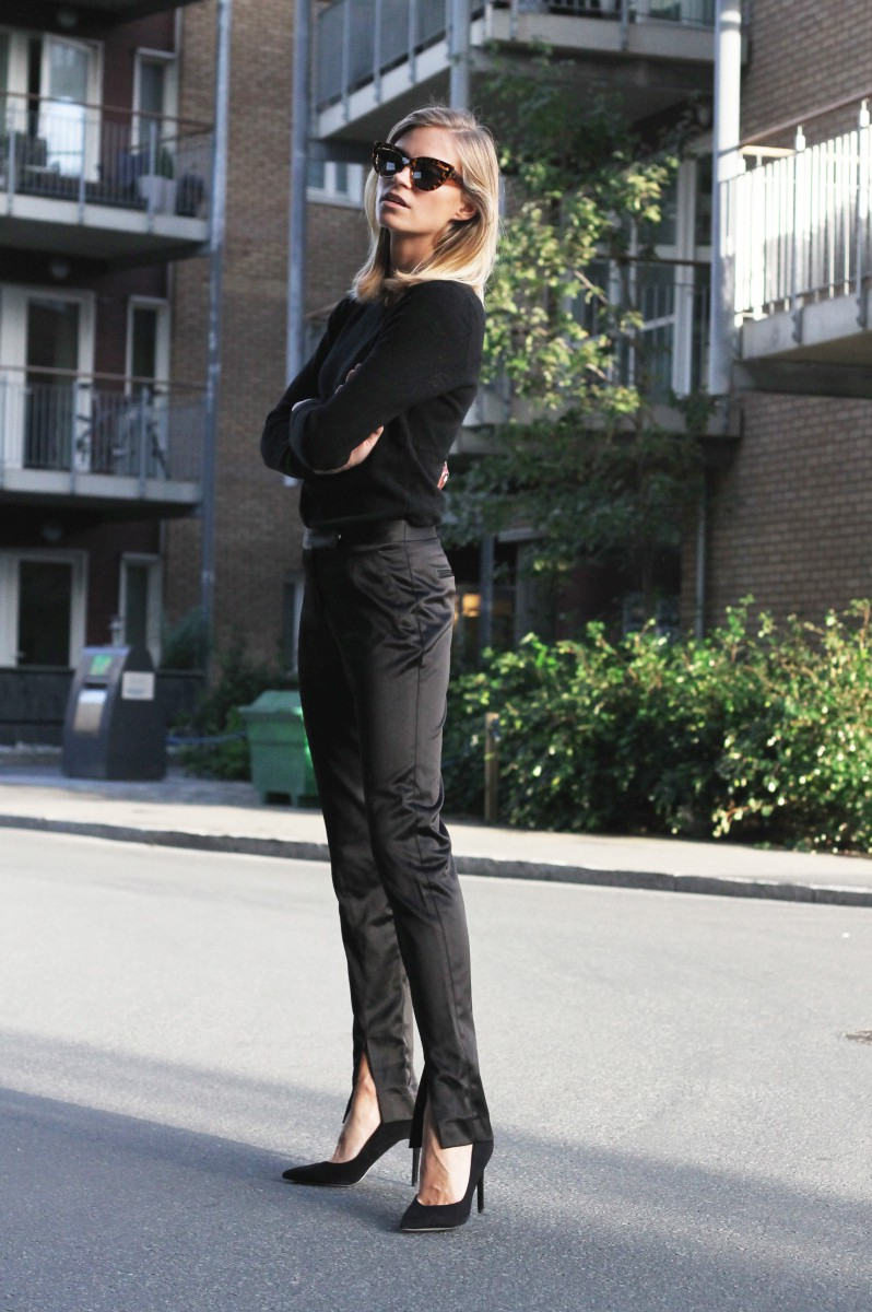 Tine Andrea is wearing all black trousers shoes from Asos, sweater from Alexander Wang
