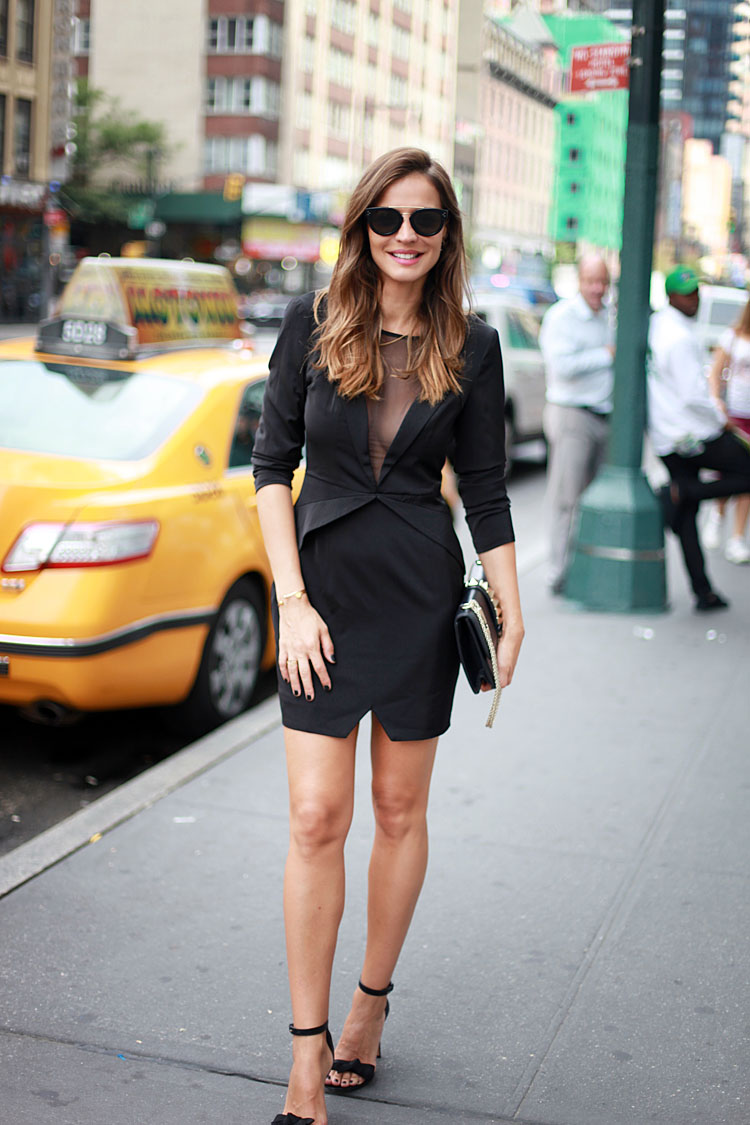 Silvia Zamora is wearing a black dress from Revolve Clothing, sandals from Isabel Marant sandals, sunglasses from Celine and the bag is from Valentino