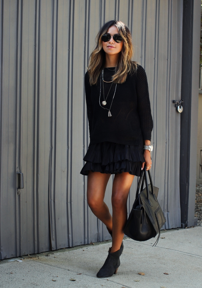 Julie Sarinana is wearing all black, ruffle skirt from Elizabeth & James, knit top from Demylee, boots from Isabel Marant and a bag from Celine