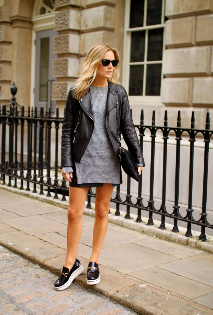 Lucy Williams is wearing a grey jumper from Zara, black skirt from All Saints, flatforms from Stella McCartney, bag from Baukjen and the leather jacket from Belstaff