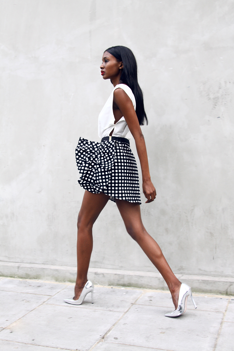 Natasha Ndlovu is wearing a dress from SelfPortrait and the metallic shoes are from Asos