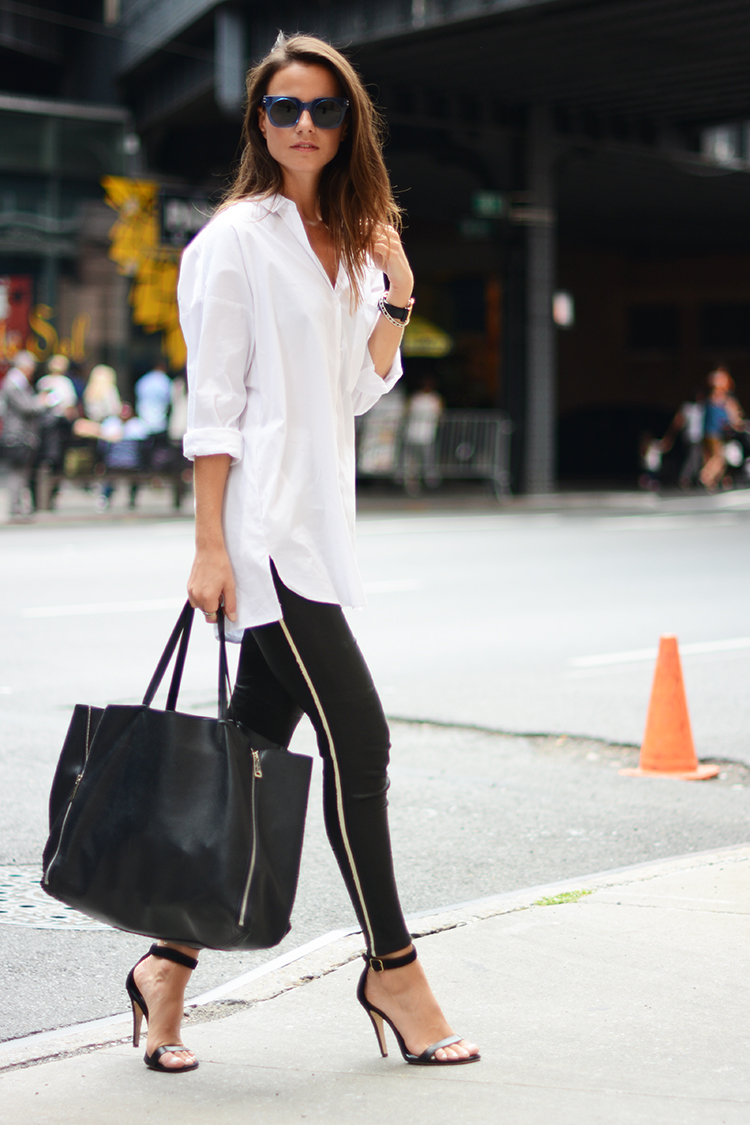 Zina Charkoplia is wearing black leather trousers from Iro, sandals from Purificacion Garcia, sunglasses from Marc Jacobs, bag from Celine and the shirt is from Zara