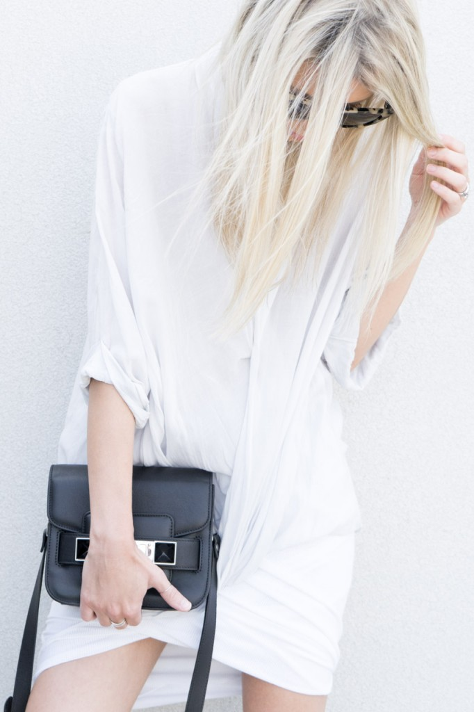 Figtny is wearing a white top from Helmut Lang, a wrap skirt from Alexander Wang and a tiny bag from Proenza Schouler