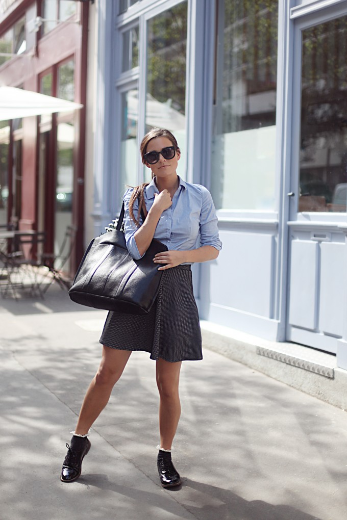 Audrey Leighton Rogers is wearing a pale blue shirt and a black and white skirt from Tally Weijl and the brogues from Patent Oxford